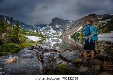 Backpacker looks at Lake Isabelle Brainard Lake Recreation Area - Colorado Tourism,