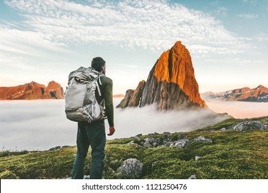 Backpacker man exploring sunset rocky mountains alone hiking adventure journey summer vacations traveling lifestyle weekend getaway