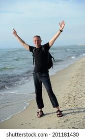 Backpacker on the sandy beach