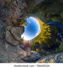 Backpacker on top of a rock fall at dawn. spherical degree panorama 360 180 little planet.