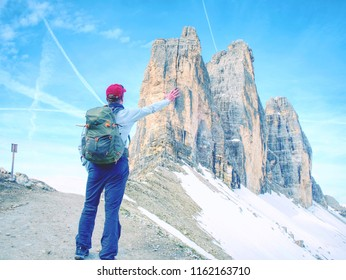 Backpacker on trip aound  Tre Cime di Lavaredo in sunny April  morning. View from tour around popular massive, Dolomite Alps,  Italy
