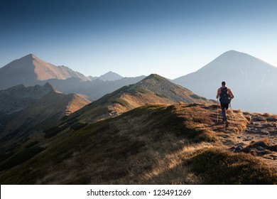 Backpacker at Ornak Peak in Tatra Mountains, Poland