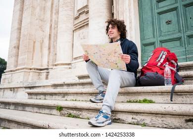Backpacker tourist holding a tourist map