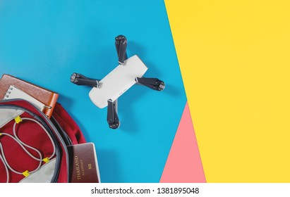 Backpacker tourist travel gadgets and objects in Backpack with drone and camera vlogger objects