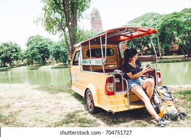 Backpacker trave Ayutthaya Thailand by Tuk Tuk small passenger in Holiday, She look the picture in her camera