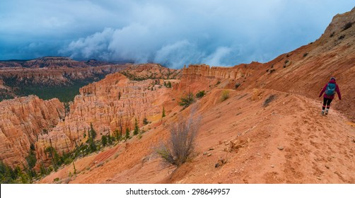 Backpacker walking down the Peek-a-boo loop trail Bryce Canyon National Park