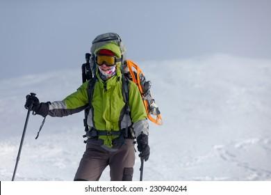 Backpacker woman posing in winter mountains