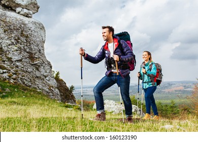Backpackers hiking. Two young tourists on the trial