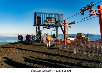 Backpackers and tourists around cable car at Volcano villarrica
