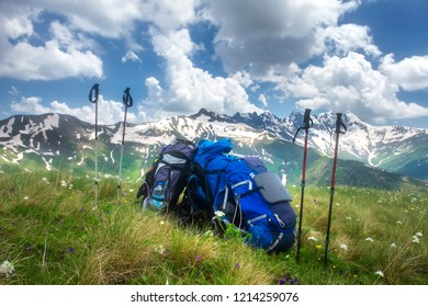 Backpacks and mountain walking sticks in hiking trail. Hiking in mountains concept. Sport tourism