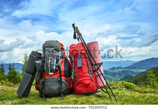 Backpacks in the mountains with views of the mountains.