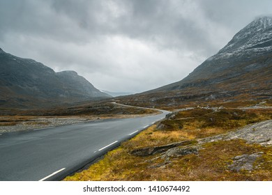 Backplate of mountain tarmac road during rain and with fog. Norwegian simple minimalistic landscape.