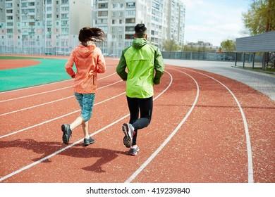 Backs of runners