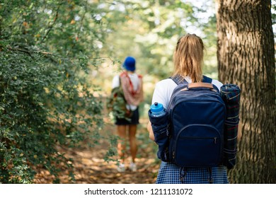 Backshot of Young woman on hiking with backpack in forest