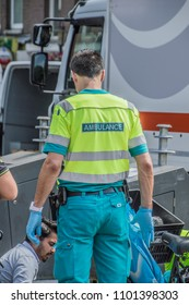 Backside Of An Ambulance Employee At Amsterdam The Netherlands 2018