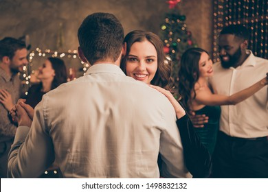 Backside close up photo of lovely lady dancing with her sweetheart on christmas night x-mas party meeting with her fellows have formal wear in house indoors
