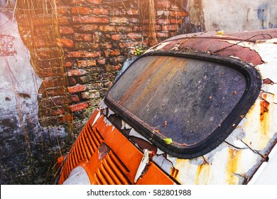 Backside of dirty old car window with brick wall background