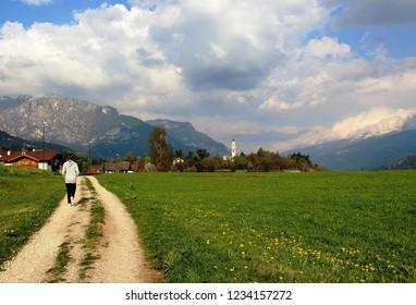 Backside girl on trail in Cavalese, Trentino Alto Adige, Italy
