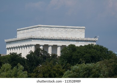 Backside of the Lincoln Memorial, partially obscured by trees, photographed September 7, 2012