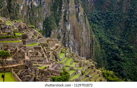 Backside of Machu Picchu surrounded by dense green forests