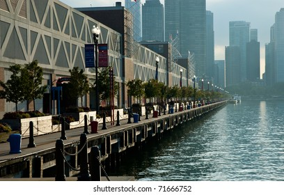 The backside of Navy Pier stretching back towards the Chicago skyline at sunset.