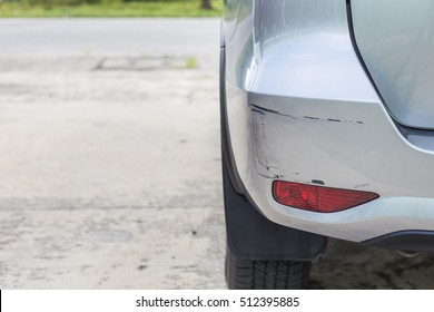 Backside of new silver SUV car get scratched, damaged by accident