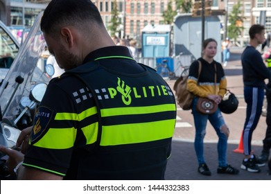 Backside Of A Police Man At Amsterdam The Netherlands 2019