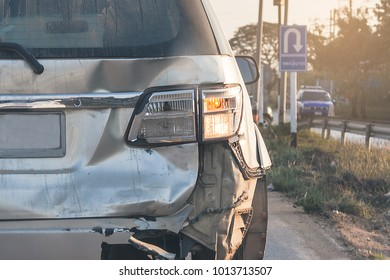 Backside  silver car get damaged by crash accident on the road.