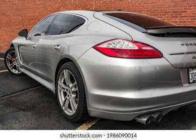 Backside of Silver Porsche Panamera