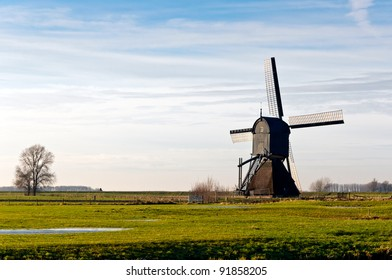 "Backside of the windmill ""Zandwijkse Molen"" dated from 1699 in the Dutch village of Sleeuwijk (municipality of Woudrichem, province of North Brabant). This mill is no longer in use as a polder mill."