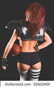 Backside of a Young Female Football Player