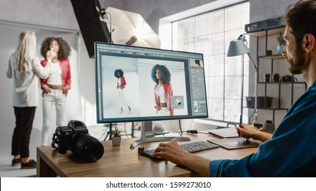Backstage of the Photoshoot: Make-up Artist Applies Makeup on Beautiful Black Girl. Photo Editor Works on Desktop Computer Retouching Photo with Image Editing Software. Fashion Internet Magazine