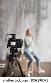 backstage to photoshooting in studio with professional photo camera