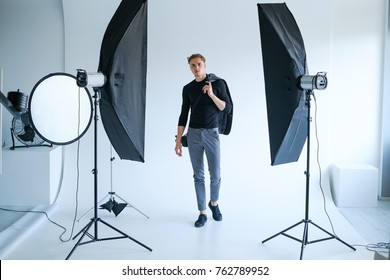 backstage self-confident man equipment workplace photo studio concept. Photography of fashion look.
