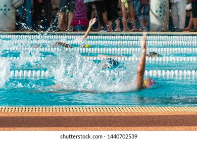 The backstroke in the pool,Children in swimming pool , Asian Children , Thailand.
