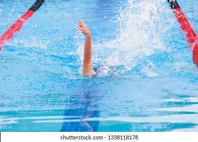 Backstroke swimmer in a race