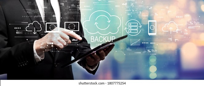 Backup concept with businessman using his tablet computer