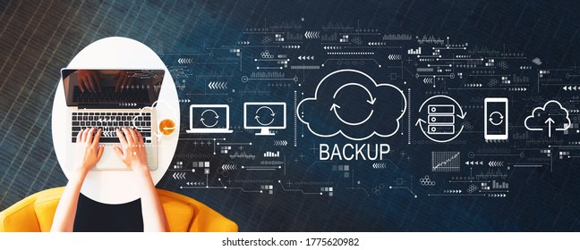Backup concept with person using a laptop on a white table
