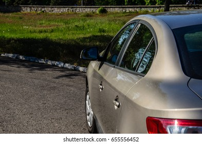 Backview of the car parked in the street