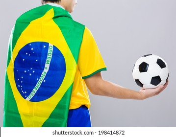 Backview of football player wear with Brazil flag and hold football