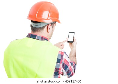 Backview of male engineer holding mobile phone with blank screen and copyspace isolated on white
