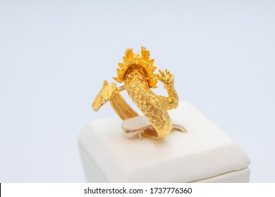 backward of golden dragon shape ring made from gold 99.99% in jewellery shop