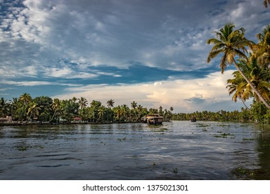backwater Houseboat with blue sky,white cloud and palm tree.