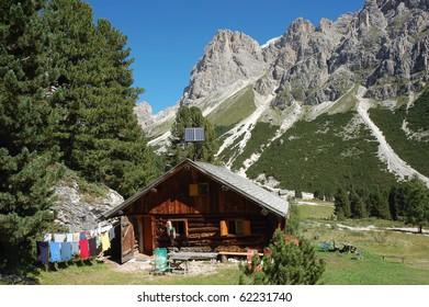 Backyard of alpine farm in Italian Dolomites.