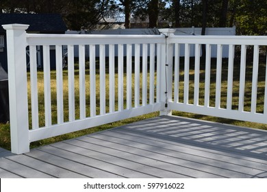 backyard deck and vinyl fence railing
