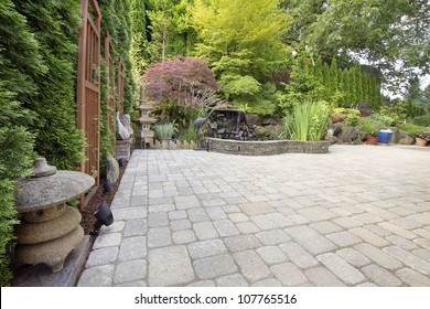 Backyard Garden Asian Inspired Paver Patio with Pagoda Pond Bronze and Stone Sculptures
