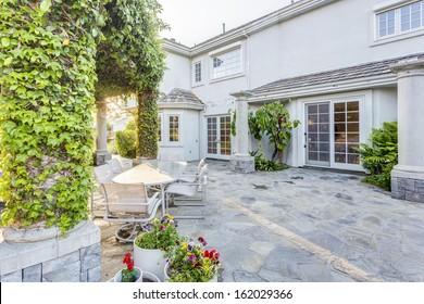 Backyard garden of luxury house at sunset