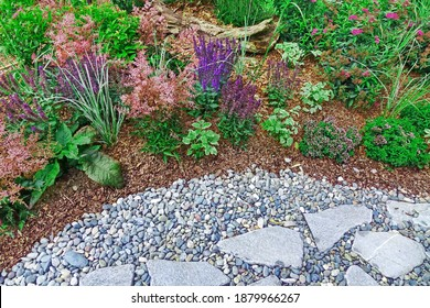 Backyard Garden Modern Designed Landscaping. Decorative Garden Design. Back Yard Lawn And Natural Mulched Border Between Grass, Plants And Pebble, Gravel Or Stone Walk Path. - Shutterstock ID 1879966267