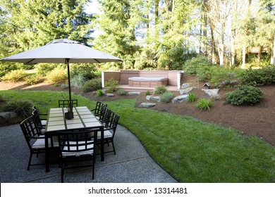 Backyard of a house with a patio set and jacuzzi