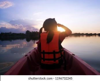 backyard of kid on kayak to travel on pond in adventure trip in summer